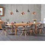 Verona 180cm Solid Oak Extending Dining Table with Oscar Faux Leather Round Leg Chairs